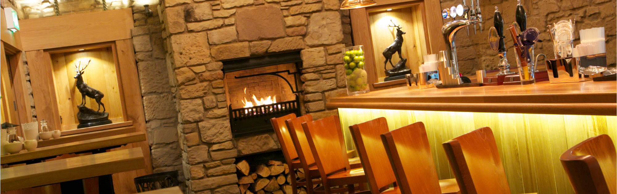 Cosy Atmosphere: Enjoy one of our many ales from the bar before or after your meal